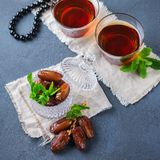Ramadan ramazan kareem. Traditional arabic tea with mint and dates. For iftar party holidays Stock Photo