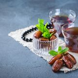 Ramadan ramazan kareem. Traditional arabic tea with mint and dates. For iftar party holidays Royalty Free Stock Images