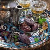 Ramadan: ripe dates and green tea Stock Photos
