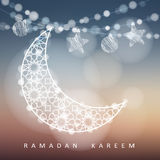 Ramadan string with ornamental moon, stars, balls and bokeh lights. Blurred illustration background. Ramadan card. Ramadan string with ornamental moon, stars
