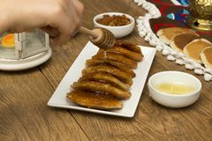 Ramadan Sweets - Qatayef. Pouring honey on Qatayef - Traditional middle eastern sweets , usually eaten in Muslims holy month : Ramadan royalty free stock photography