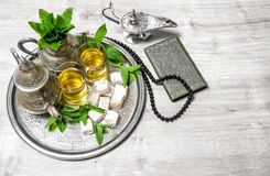 Ramadan. Tea table setting, holy book quran and rosary Royalty Free Stock Photo