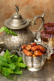 Ramadan tradition. Silver bowl filled with dates as traditional Ramadan treat