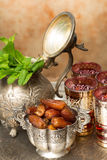 Ramadan treat. Moroccan tea tray with mint leaves and ramadan cookies and dates