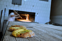 Ramadans traditonal bread. Bakery in Prizren making Ramadans traditonal bread with creamy cheese and eggs in the middle, baked in a wood oven, a Ramadan Stock Photography