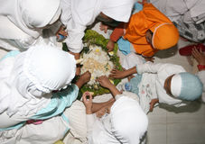Ramadhan. Children Islamic elementary school students eat together during fasting in living worship in holy month of Ramadan, in Solo, Central Java, Indonesia Royalty Free Stock Photos