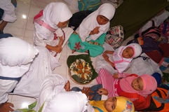 Ramadhan. Islamic elementary school students do iftar in Ramadan in the city of Solo, Central Java, Indonesia Stock Images