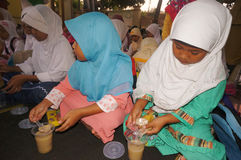 Ramadhan. Islamic elementary school students do iftar in Ramadan in the city of Solo, Central Java, Indonesia Stock Image