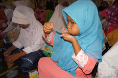 Ramadhan. Islamic elementary school students do iftar in Ramadan in the city of Solo, Central Java, Indonesia Royalty Free Stock Photo