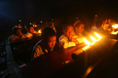 Ramadhan. Islamic school students learning the Quran by lighting oil lamps in the month of Ramadan in the town of Solo, Central Java, Indonesia Stock Photos