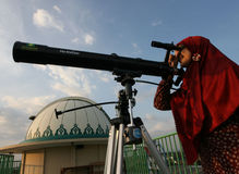 Ramadhan. Muslims observe the appearance of the new moon with the telescope which signifies the coming holy month of Ramadan in Solo, Central Java, Indonesia Stock Image