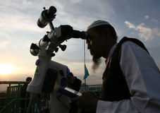 Ramadhan. Muslims observe the appearance of the new moon with the telescope which signifies the coming holy month of Ramadan in Solo, Central Java, Indonesia Royalty Free Stock Image