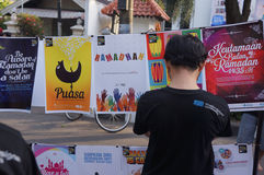 Ramadhan. People saw the exhibition of Islamic posters ahead of Ramadan in the city of Solo, Central Java, Indonesia Stock Images