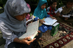 Ramadhan. Ramadan when the children were reading Koran at a park in the city of Solo, Central Java, Indonesia Stock Image