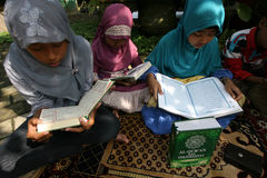 Ramadhan. Ramadan when the children were reading Koran at a park in the city of Solo, Central Java, Indonesia Royalty Free Stock Photography