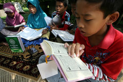 Ramadhan. Ramadan when the children were reading Koran at a park in the city of Solo, Central Java, Indonesia Royalty Free Stock Images