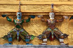 Ramakien figures on the golden chedi Stock Photo