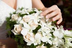 Ramalhete com mão da noiva Foto de Stock