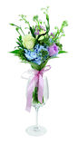 Ramalhete das flores em um vidro em um fundo branco Fotos de Stock Royalty Free