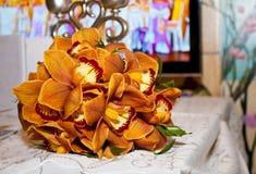 Ramalhete de orquídeas alaranjadas Imagens de Stock Royalty Free
