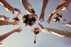 Ramalhetes da captura das mãos Imagens de Stock Royalty Free