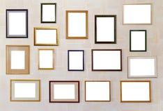 ramar hänger många den olika väggen för fotoet Arkivbilder