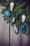 Ramas con las decoraciones de la Navidad Fotografía de archivo libre de regalías