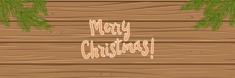 Ramas de árbol de navidad en un fondo de madera Visión superior cristo Imagen de archivo libre de regalías