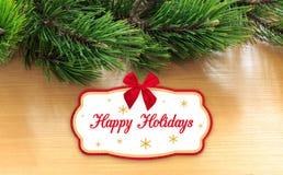 Ramas del pino de la tarjeta de felicitación Foto de archivo libre de regalías