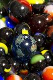 Ramassage de la terre et de marbre Photographie stock libre de droits