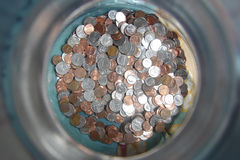 Ramassage de pièce de monnaie photographie stock libre de droits