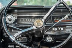 Cadillac Coupe Deville 1964 interior - steering wheel with logo and dashboard royalty free stock photo