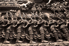 The Ramayana Epic carved from wood. The part of Ramayana Epic carved from wood Stock Photo