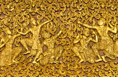 The ramayana epic carved on a wood door inside a t. Emple. Luang Prabang, Laos Royalty Free Stock Images