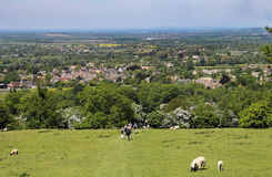 Ramblers on a Cotswold trail into Broadway Village Stock Photo