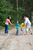 Rambling family in the forest Royalty Free Stock Photos
