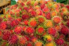 Rambutan ai mercati all'ingrosso Immagini Stock