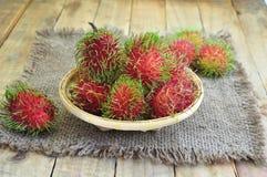 Rambutan. Asian Fruit On Bamboo Basket Royalty Free Stock Photos