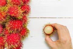 Rambutan Background / Rambutan / Rambutan on Wooden Background Stock Photos