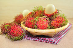 Rambutan. In Bamboo Basket on Wooden Background Stock Photography