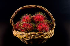 Rambutan in basket on black background. Rambutan in basket on a black background Stock Photography