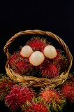 Rambutan in basket on black background. Rambutan in basket on a black background Stock Image
