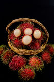 Rambutan in basket on black background. Rambutan in basket on a black background Stock Photos