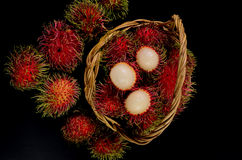 Rambutan in basket on black background. Rambutan in basket on a black background Royalty Free Stock Image