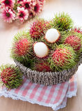 Rambutan in the basket Royalty Free Stock Photography