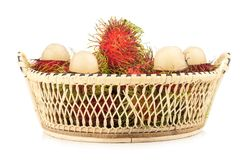 Rambutan in basket isolated on white background.  Stock Photos