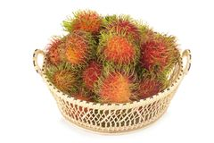 Rambutan in basket isolated on white background.  Royalty Free Stock Photos