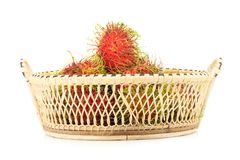 Rambutan in basket isolated on white background.  Stock Images