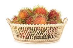 Rambutan in basket isolated on white background.  Royalty Free Stock Images