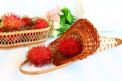 Rambutan in basket. On vintage style on retro background Royalty Free Stock Image